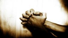 Praying hands 496x279
